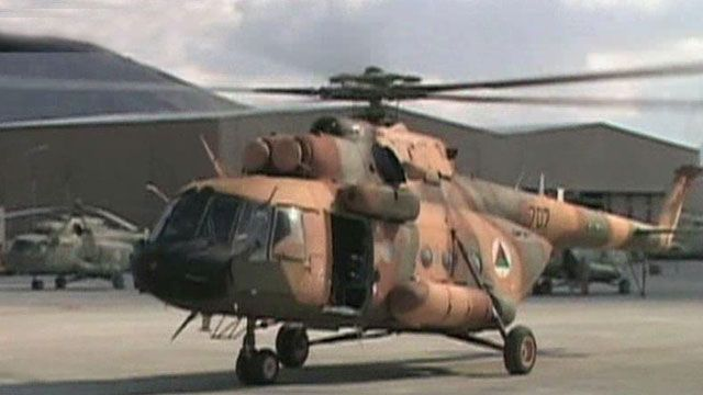 Report: Afghan air force probed in drug, gun smuggling