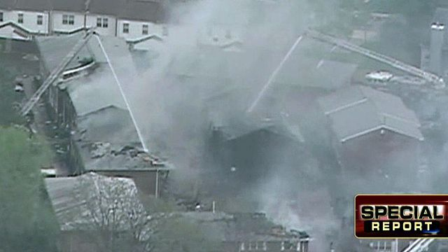 Navy jet crash wipes out part of apartment complex