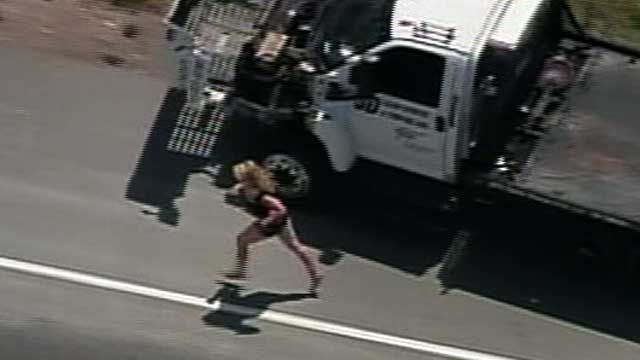 Woman Flees Police in Tow Truck