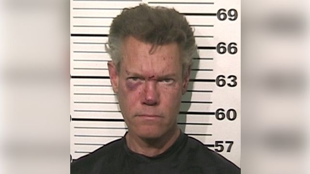 Randy Travis reportedly naked, threatened cops during arrest