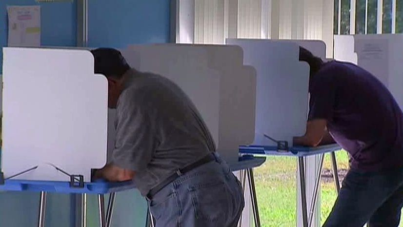 Texas attorney general vows appeal of voter ID law ruling