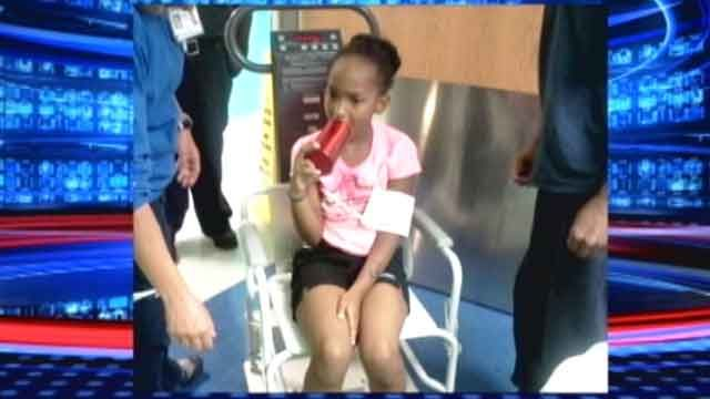 8-year-old gets tongue stuck inside water bottle